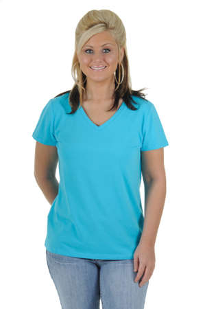 A pretty woman wearing a plain blue tee shirt, isolated on a solid white background. Foto de archivo