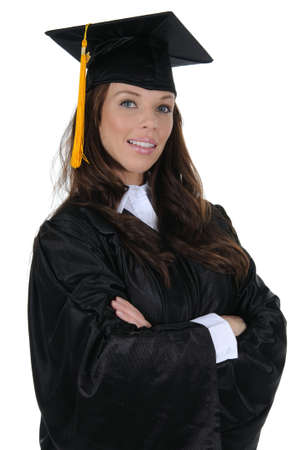 cap and gown: A confident woman graduate wearing a black cap and gown with gold tassel, isolated on a solid white background.