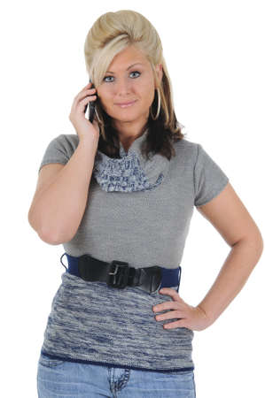 A attractive young blonde woman taking a call on her smart phone. Isolated on a solid white background.