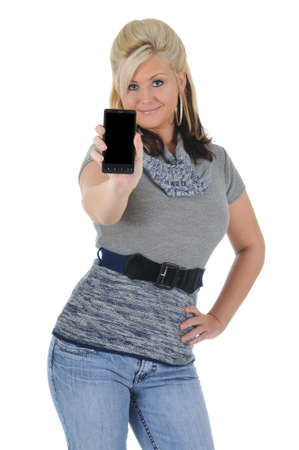 A attractive young blonde woman displaying her smart phone. Isolated on a solid white background.