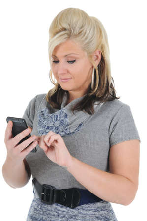 A attractive young blonde woman texting on her smart phone. Isolated on a solid white background.