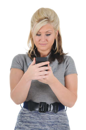 A attractive young blonde woman reading a text message on her smart phone. Isolated on a solid white background.  photo