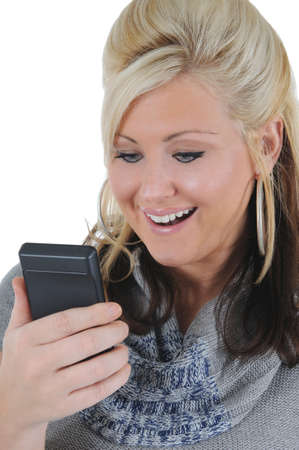 A attractive young blonde woman receiving good news on her smart phone. Isolated on a solid white background.