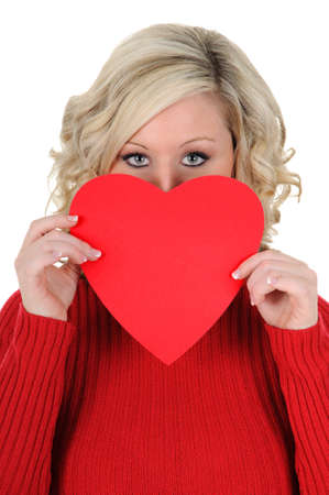 A charming young woman holding a paper heart. Valentines Day concept. Isolated on a solid white background.