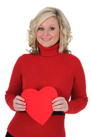 A charming young woman holding a paper heart. Valentine's Day concept. Isolated on a solid white background.