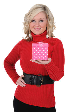 A charming young woman holding a pink gift box. Valentines Day concept. Isolated on a solid white background.  photo