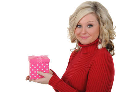 A charming young woman holding a pink gift box. Valentines Day concept. Isolated on a solid white background.