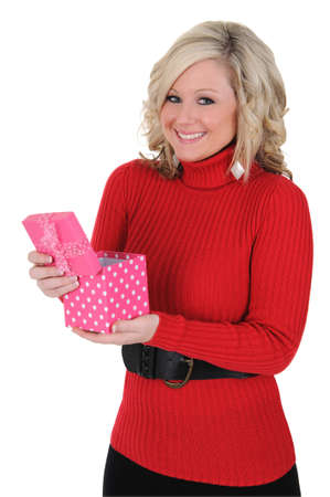 A  lovely young woman happy with her gift. Valentine's Day concept. Isolated on a solid white background.