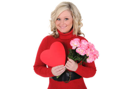 A beautiful young woman holding a paper heart and bouquet of pink roses. Valentine