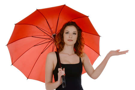 Young woman with red umbrella checking if its raining, isolated on white background Stok Fotoğraf