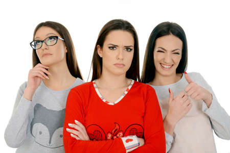 Three girls in three different face expression. Friendship, people and pajama party concept - happy friends or teenage girls having fun