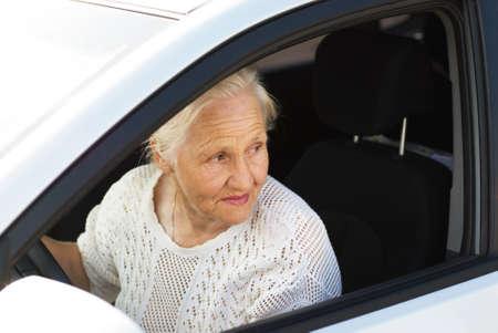 Elderly woman driving car photo