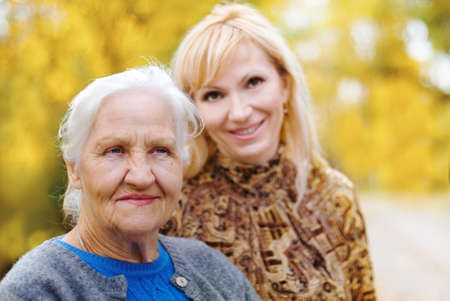 Elderly woman with daughter in a garden Stock Photo