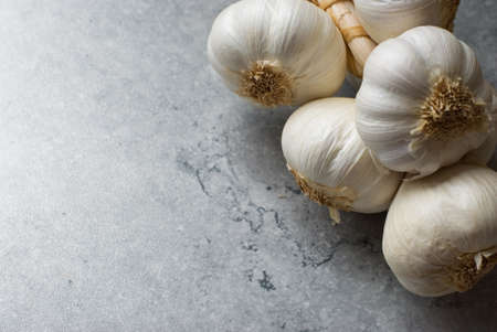 antiseptic: Bunch of garlic on a vintage background, with place for text Stock Photo
