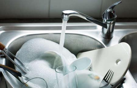 Washing kitchen ware on a sink