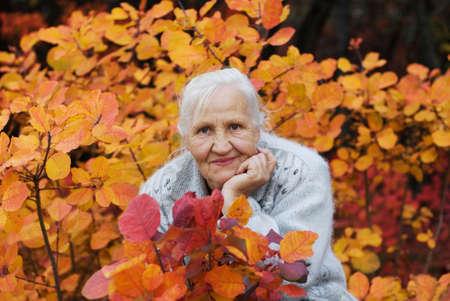 Elderly women at the autumn background