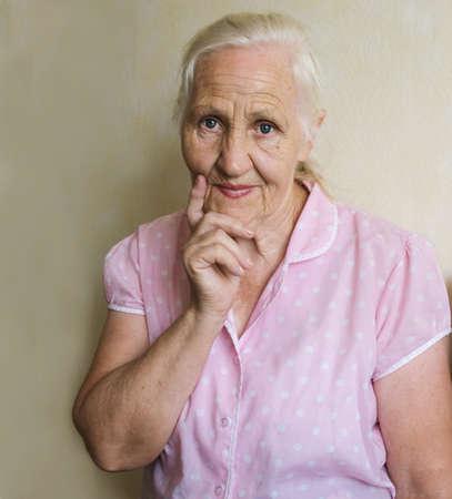 Thoughtful elderly woman Standard-Bild