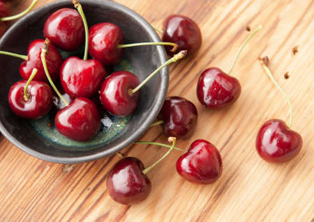 pulpy: Sweet fresh cherries in a ceramic bowl