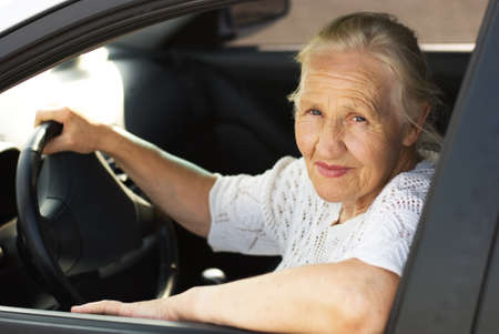 Elderly woman in the car  photo