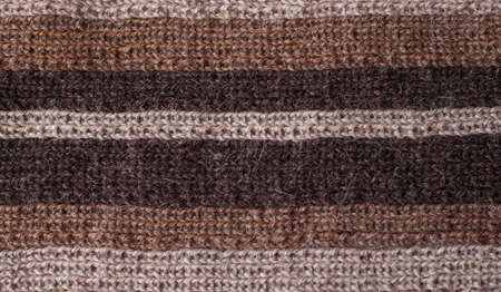 Knitted background, striped warm scarf photo