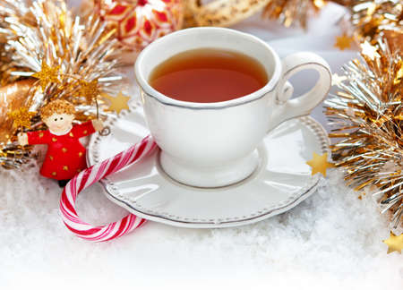 Christmas cup of tea with Christmas decor photo