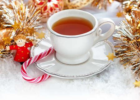 sante: Christmas cup of tea with Christmas decor Stock Photo