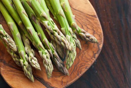 Bunch of fresh asparagus on a wooden table photo