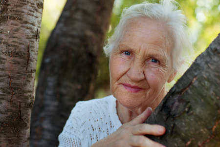 Portrait of the smiling elderly woman, outdoor