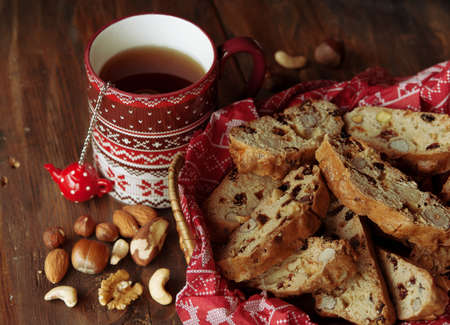 crumbly: Cup of tea and Biscotti, cookies with nuts, dried fruits