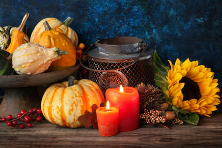 autumn arrangement: Autumn thanksgiving decor with candle, sunflower and pumpkin