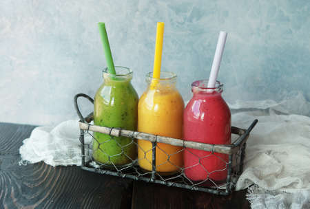blended: Three fresh blended Fruit Smoothies in jar Stock Photo
