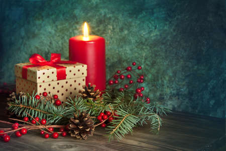 christmas decor: Christmas present with red ribbon, decor with red candle