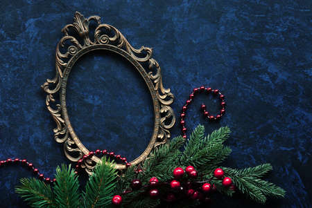 stock photo vintage metal oval frame on a dark background with christmas decoration - Metal Frame Christmas Decorations
