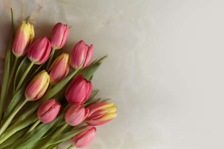 Bouquet of beautiful flowers, spring tulips on a marble background Archivio Fotografico - 125805582