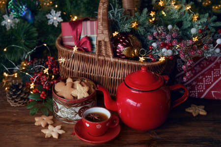 Christmas hot tea and cookies at the table with christmas decoration and gifts Archivio Fotografico - 135294466