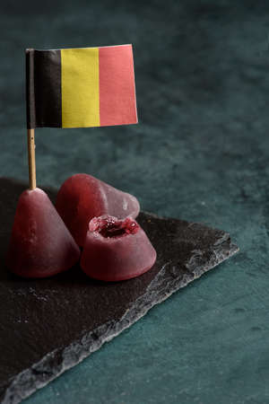 Cuberdons Belgian candy, made with gum arabic candy crust with a soft, traditionally raspberry-flavored inside filling Archivio Fotografico - 131757110