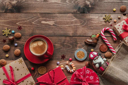 Saint Nicholas chocolate with gifts and cup of coffee