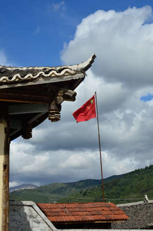 seperation: Tibetan temple with China flag in the background