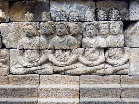 The 9th-century stone carving at BorobudurTemple, telling the story of Buddhism, in Magelang Regency, near Yogyakarta, Indonesia
