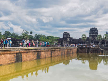 Siem Reap, Cambodia - October 30, 2016: Tourists visit Angkor Wat, UNESCO World Heritage site, in Cambodia