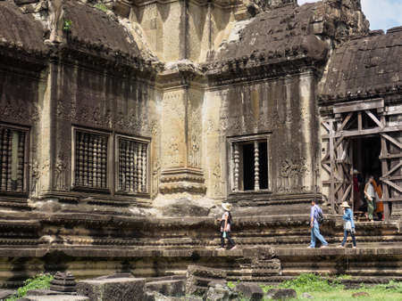 Siem Reap, Cambodia - October 30, 2016: the 12th century temple building in Angkor Wat, UNESCO World Heritage site, in Cambodia, visited by tourist.