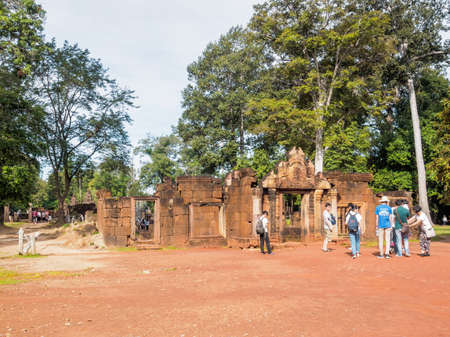 Siem Reap, Cambodia - October 30, 2016: Tourists visit the  Banteay Srey or Banteay Srei Temple which is the 10th century Hindu temple in Siem Reap, Cambodia.