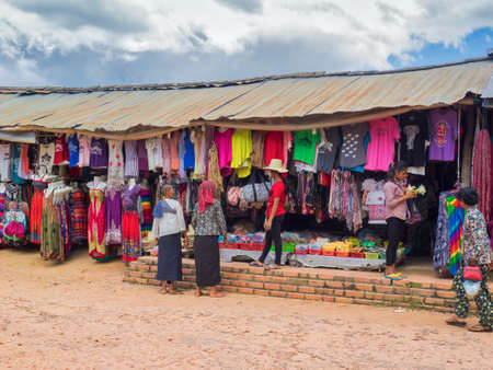 Siem Reap, Cambodia - October 31, 2016: Cambodian shoppers looking for colorful clothes at market near West Baray or West water reservoir in Siem Reap, Cambodia.