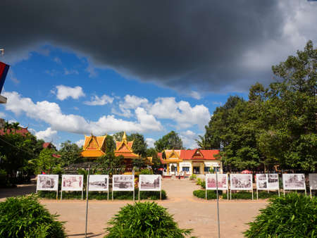 Siem Reap, Cambodia - October 31, 2016: Wat Thmey or Thmey Temple, one of killing field sites in Cambodia displaying the old photographs of civil war in Cambodia while the dark cloud floating above th
