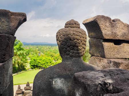 The Buddha statute at  Borobudur temple, Magelang Regency, near Yogyakarta, Java Island, Indonesia