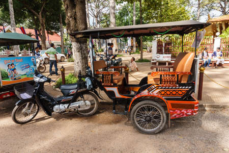 Siem Reap, Cambodia - October 29, 2016:  Modified Motorcycle  as a motorized tricycle  for carrying passengers parking in the park near Preah Ang Chek and Ang Chom Shrine, at Siem Reap, Cambodia, 報道画像