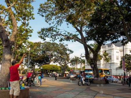 Penang,  Malaysia - June 02, 2016: Young people watched an unidentified man playing soap bubbles at the wide footpath of Janlan (Road) Tun Syed Sheh Barakbah, along the coast of  George town, Penang,