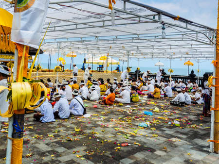 Bali, Indonesia - September 17, 2016: Balinese worshippers gathering at Tanah Lot Temple for the Galungan festival celebrating the return of Balinese gods and deified ancestors to Bali.