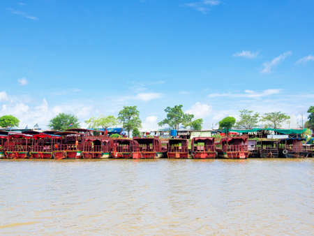 Siem Reap, Cambodia - October 29, 2016: Tourist boats are at anchor at the bank of Tonle Sap, the large freshwater lake in Siem Reap, Cambodia.