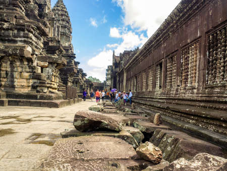 Siem Reap, Cambodia - October 30, 2016: Angkor Wat, the 12th century temple which is situated in Siem Reap, Cambodia, and  the UNESCO World Heritage site,  visited by various tourists.